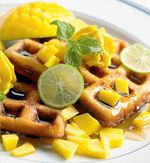 Banana Waffles with Passion Fruit Rum Syrup and Mango Butter