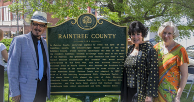 Stand-ins with Raintree County plaque